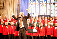 Haydn James leads community singing at Commonwealth Carnival of Music